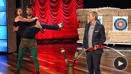 Josh Duhamel gives Ellen Degeneres an archery lesson. Photo: EllenTV